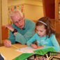 Volunteer helping student learn to read